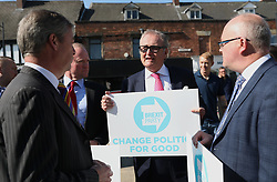 (centre) Yorkshire's European election candidate John Longworth speaks to Brexit Party leader Nigel Farage (left) while on the European Election campaign trail in Pontefract, West Yorkshire, in the Brexit bus while . Picture dated: Monday May 13, 2019. Photo credit should read: Isabel Infantes / EMPICS Entertainment.