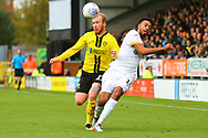 Burton Albion forward Liam Boyce (27) and Peterborough United defender Rhys Bennett (16) during the EFL Sky Bet League 1 match between Burton Albion and Peterborough United at the Pirelli Stadium, Burton upon Trent, England on 27 October 2018.