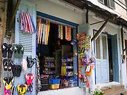 11 MARCH 2013 - LUANG PRABANG, LAOS:  A shop in a colonial era building that sells assorted goods in Luang Prabang, Laos.   PHOTO BY JACK KURTZ