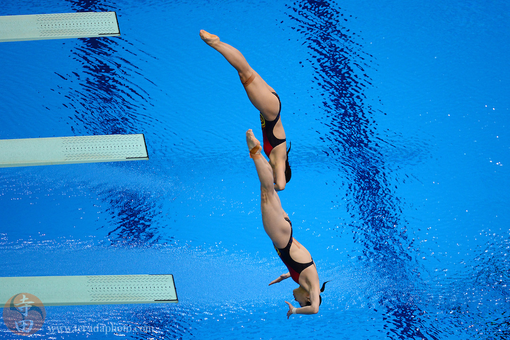 Jul 29, 2012; London, United Kingdom; China divers He Zi (back) and Wu Minxia (front) dive during the women's 3m synchro finals during the 2012 London Olympic Games at Aquatics Centre.