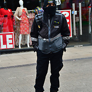 A Security Man During the coronavirus in UK lockdown, at Walthamstow Market, London.