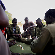 A group of Sudan People's Liberation Movement (SPLA-N) rebel fighters relax outside Jebel Kwo military base near Tess village in the rebel-held territory of the Nuba Mountains in South Kordofan.