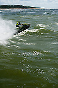 A man enjoys a jet ski in the Baltic Sea just off shore from Palanga, Lithuania