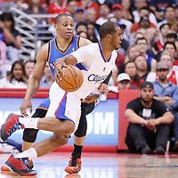 11 May 2014: Los Angeles Clippers guard Chris Paul (3) drives past Oklahoma City Thunder guard Russell Westbrook (0) during the Los Angeles Clippers 101-99 victory over the Oklahoma City Thunder, during Game Four of the Western Conference Semifinals of the NBA Playoffs, at the Staples Center, Los Angeles, California, USA.