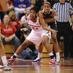 Rutgers Scarlet Knights forward/center Monique Oliver (44) defends West Virginia Mountaineers center Asya Bussie (20) in the paint during first half Big East NCAA women's basketball action between Rutgers and West Virginia at the Louis Brown Rutgers Athletic Center