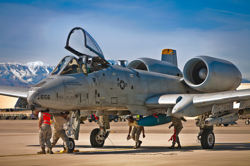 "An A-10 Thunderbolt is checked by a safety team prior to participating in a ""Red Flag"" exercise at Nellis AFB, Nevada."