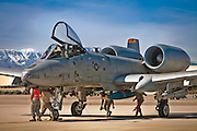 """An A-10 Thunderbolt is checked by a safety team prior to participating in a """"Red Flag"""" exercise at Nellis AFB, Nevada."""