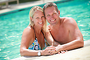 Attractive Middle Aged Couple at the Pool on Vacation