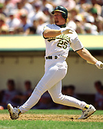 OAKLAND - CIRCA 1996:  Mark McGwire of the Oakland Athletics bats during an MLB game at the Oakland Coliseum in Oakland, California during the 1996 season. (Photo by Ron Vesely) Subject:   Mark McGwire