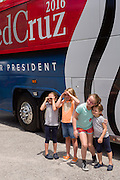 Catherine, 4, right, and Caroline, 7, left, daughters of U.S. Senator and GOP presidential candidate Ted Cruz stand with friends for a photo in front of their campaign during an event August 7, 2015 in Mt Pleasant, South Carolina. Cruz began a seven-day bus tour called the Cruz Country Bus Tour of southern states following the event.