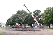 Workmen remove a pedestal that once held a statue of Confederate general and early member of the Ku Klux Klan (KKK), Nathan Bedford Forrest. The statue, that was removed in December 2017, stands over his grave in Health Sciences Park in Memphis, Tennessee, U.S. June 1, 2021. The remains of Forrest and his wife below the base will be moved to Columbia, Tennessee.