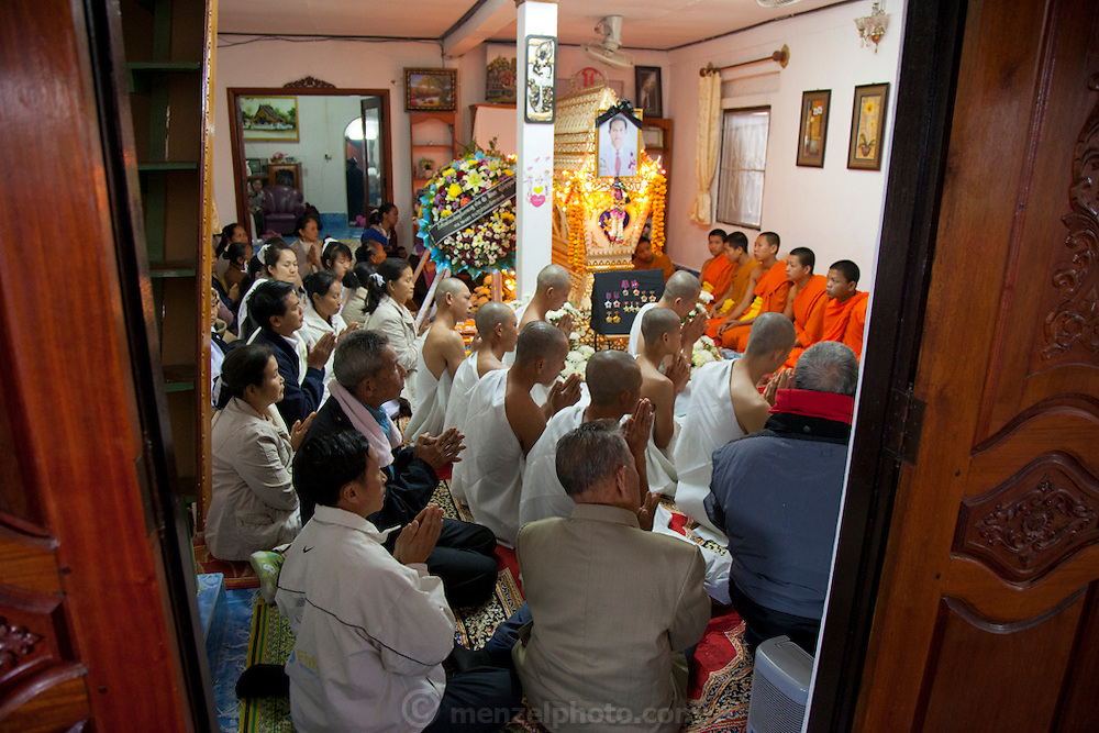Funeral of Mr. Voua Sy Amkha, 63, at home in Ban Navieng Kham village, a suburb of Luang Prabang, Laos, and then cremation at the central crematorium site in Ban Vieng Mai. The propaganda official for the Lao government in Luang Prabang died of a stroke.