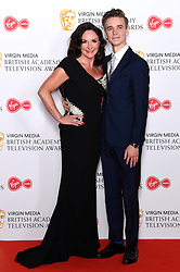 Shirley Ballas and Joe Sugg in the press room during the Virgin Media BAFTA TV awards, held at the Royal Festival Hall in London. Photo credit should read: Doug Peters/EMPICS