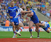 Warrington Wolves Chris Hill is held by Wakefield Trinity Wildcats Scott Moore and Andy Yates during the Ladbrokes Challenge Cup Semi-Final  match Warrington Wolves -V- Wakefield Trinity Wildcats at , Leigh, Greater Manchester, England on Saturday, July 30, 2016. (Steve Flynn/Image of Sport)