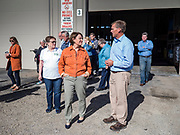 18 OCTOBER 2019 - CRAWFORDSVILLE, IOWA: US Senator AMY KLOBUCHAR (D-MN), center, and PATTY JUDGE, from Focus on Rural America, left, listen to ROYDON STROM, President and CEO of W2 Fuel during a tour of W2 Fuel, a biodiesel refinery that used soybeans to make biodiesel. W2 Fuel closed about a month ago because of low demand for biofuels, brought on by the number of biofuels waivers the US EPA has given to petroleum refineries. Sen. Klobuchar is on barnstorming bus tour of southeast Iowa this weekend. She is campaigning to be the Democratic nominee for the US Presidency. In addition to campaign meet and greet events, she stopped at a biofuels plant to learn about the difficulties farmers and biofuels producers face because of the trade war with China. Iowa holds the first selection event of the Presidential election cycle. The Iowa caucuses are Feb. 3, 2020.          PHOTO BY JACK KURTZ