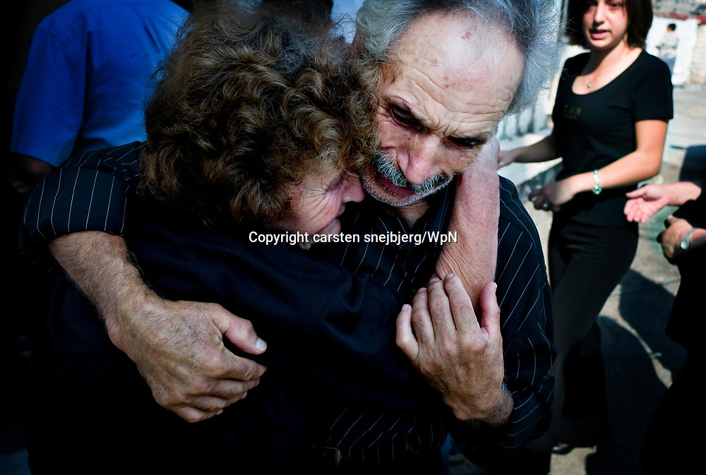 Funeral held for a 70-year-old woman and her two grand kids in Artemida, Greece, on Friday, Aug. 31, 2007<br /> <br /> These 3 persons were among the 19 people who was killed by the fire when they tried to espape the fire in and around the village of Artemida.