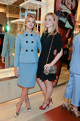 Left to right, GRETA BELLAMACINA and AMBER ATHERTON at the Roger Vivier 'The Perfect Pair' Frieze cocktail party celebrating Ambra Medda & 'Miss Viv' at the Roger Vivier Boutique, Sloane Street, London on 15th October 2014.