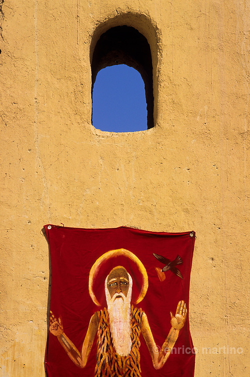 St. Paul Coptic monastery nestled in the mountains near  the Red Sea, built upon the cave where lived the first hermit, St Paul. Image of St Paul of Thebes (228-348 AD).