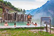 Tourists in the pool of natural hot water springs in Kheerganga, a place in Parvati valley in Kullu, Himachal Pradesh, India