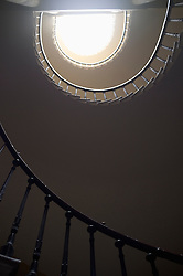 Spiral staircase from below light banister