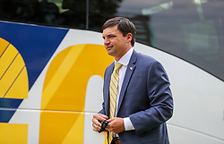 Sep 18, 2021; Morgantown, West Virginia, USA; West Virginia Mountaineers head coach Neal Brown walks off the bus as his team arrives for their game against the Virginia Tech Hokies at Mountaineer Field at Milan Puskar Stadium. Mandatory Credit: Ben Queen-USA TODAY Sports