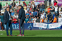 Football - 2017 / 2018 Premier League - Swansea City vs. Stoke City<br /> <br /> Swansea City manager Carlos Carvalhal & his assistant stand in the middle of the pitch after Swansea lose & are relegated as fans hang two  banners saying 'no ambition no investment sold out ' and 'ambition is the fist step to success the 2nd is action',  , at The Liberty Stadium.<br /> <br /> COLORSPORT/WINSTON BYNORTH