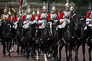 On US President Donald Trump's first day of a controversial three-day state visit to the UK by the 45th American President, Life Guards on their horses trot down the Mall, on 3rd June 2019, in London England.