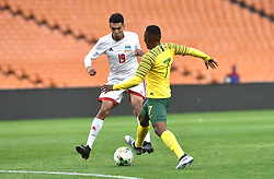 South Africa: Johannesburg: Bafana Bafana player Lebohang Maboe battle for the ball with Seychelles player Karl Hopprich during the Africa Cup Of Nations qualifiers at FNB stadium, Gauteng.<br />Picture: Itumeleng English/African News Agency (ANA)