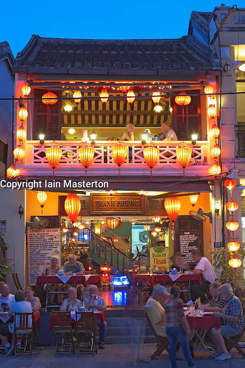 Evening view of tourist restaurant in UNESCO heritage town of Hoian in Vietnam