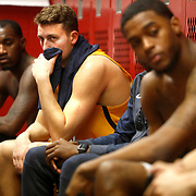 Dylan Alderson, second from left, reacts to the 99-71 loss in the locker room at Worthen Arena in Muncie, Ind., on Saturday, February 17, 2018. THE BLADE/KURT STEISS