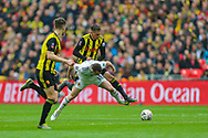 Watford defender Jose Holebas (25) performs a tackle on Wolverhampton Wanderers midfielder Diogo Jota (18) during the The FA Cup semi-final match between Watford and Wolverhampton Wanderers at Wembley Stadium, London, England on 7 April 2019.