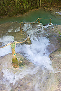 Water flowing down a natural staircase at the Mele-Maat Cascades in Vanuatu.