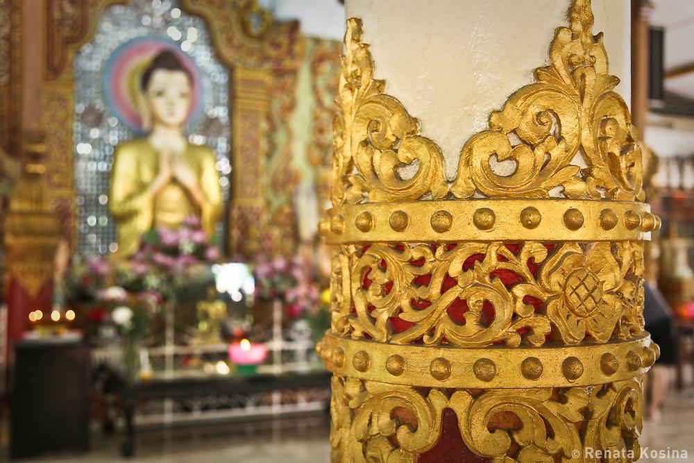 Detail of decorative woodcarvings inside the Dhammikarama Burmese Buddhist Temple on Penang, Malaysia.