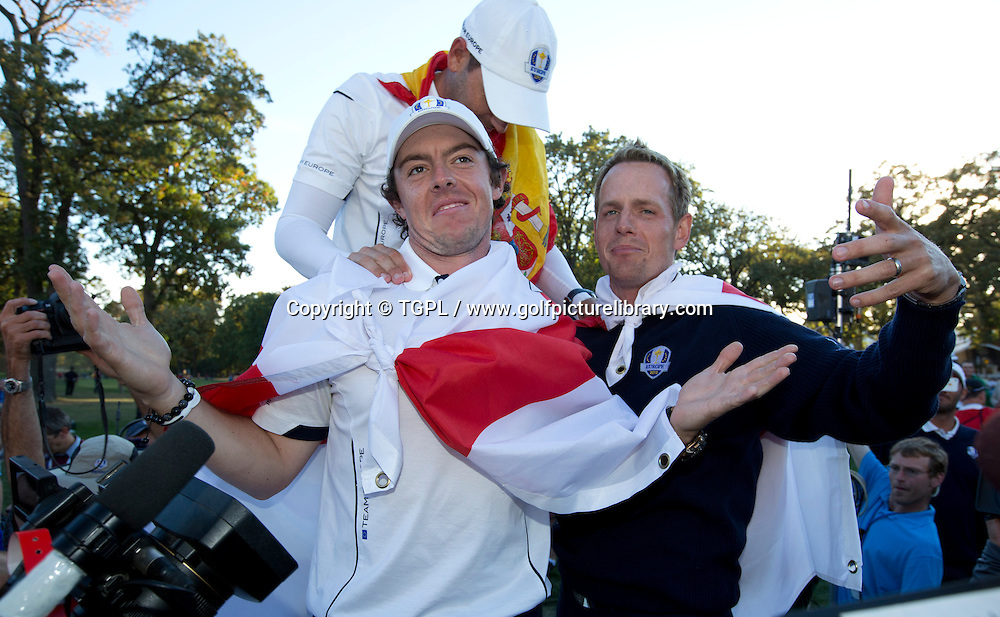 Rory MCILROY (EUR) with team mates Sergio GARCIA (EUR) and Luke DONALD (ENG) during victory celebrations during final day Singles,Ryder Cup Matches,Medinah CC,<br /> Medinah,Illinois,USA.
