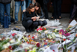 © Licensed to London News Pictures. 16/11/2015. Paris, France. Mourners visit Bataclan Cafe in Paris, France following the Paris terror attacks on Monday, 16 November 2015. Photo credit: Tolga Akmen/LNP