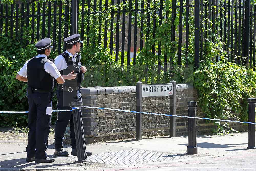 © Licensed to London News Pictures. 01/06/2019. London, UK. Police officers guard the crime scene on Seven Sisters Road, near the junction of Vartry Road in Haringey, north London, where a man in his 30s was found suffering from a stab wound to his leg. Police were called by London Ambulance Service just after 3am on Saturday, 1 June 2019. The victims condition in unknown.  Photo credit: Dinendra Haria/LNP
