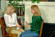 Mother age 60 counseling daughter age 26 in their home.  Minneapolis  Minnesota USA