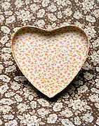 heart shaped floral box against floral background