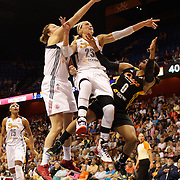 Odyssey Sims, (right), Tulsa Shock, is rejected and fouled while driving tot he basket by Katie Douglas, Connecticut Sun, assisted by team mate Kelsey Griffin, (left), during the Connecticut Sun Vs Tulsa Shock WNBA regular season game at Mohegan Sun Arena, Uncasville, Connecticut, USA. 3rd July 2014. Photo Tim Clayton