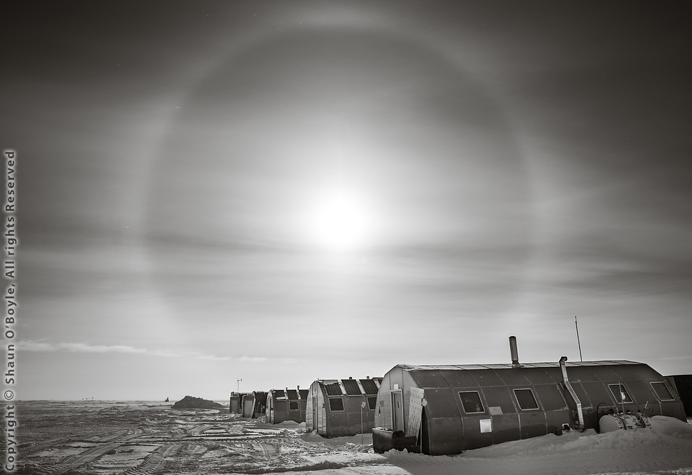 The Backyard at the South Pole. General storage place and location of carpenters, electricians, plumbers and other trade shops in these and other Quonset huts.