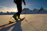 A skier traverses the Mont Collon Glacier, Haute Route, Switzerland.