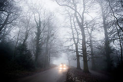 © Licensed to London News Pictures. 30/12/2016. Dorking, UK. A car reaches the top of Box Hill on another day of fog and freezing temperatures. Photo credit: Peter Macdiarmid/LNP