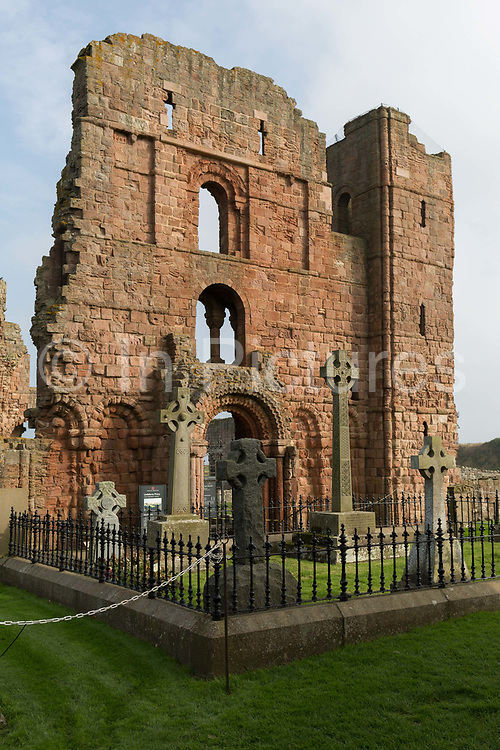 A ruined sandstone wall of the early 12th century Lindisfarne Priory, on 27th September 2017, on Lindisfarne Island, Northumberland, England. The monastery of Lindisfarne was founded by Irish monk Saint Aidan, and the priory was founded before the end of 634 and Aidan remained there until his death in 651. The Holy Island of Lindisfarne, also known simply as Holy Island, is an island off the northeast coast of England. Holy Island has a recorded history from the 6th century AD; it was an important centre of Celtic and Anglo-saxon Christianity. After the Viking invasions and the Norman conquest of England, a priory was reestablished.