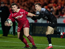 Scarlets' Scott Williams under pressure from Toulon's Chris Ashton<br /> <br /> Photographer Simon King/Replay Images<br /> <br /> European Rugby Champions Cup Round 6 - Scarlets v Toulon - Saturday 20th January 2018 - Parc Y Scarlets - Llanelli<br /> <br /> World Copyright © Replay Images . All rights reserved. info@replayimages.co.uk - http://replayimages.co.uk