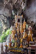 Buddha statues at Pak Ou Caves near Luang Prabang.