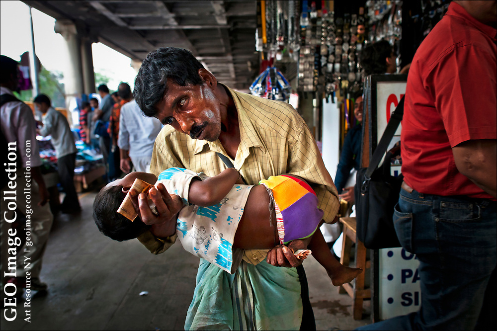 On Chowringhee Road, one of Kolkata's most ubiquitous beggars confronts passersby with a needy child.  Like the many other industries, begging in India follows an organized structure with gangs managed by drug lords and other unsavory criminals.