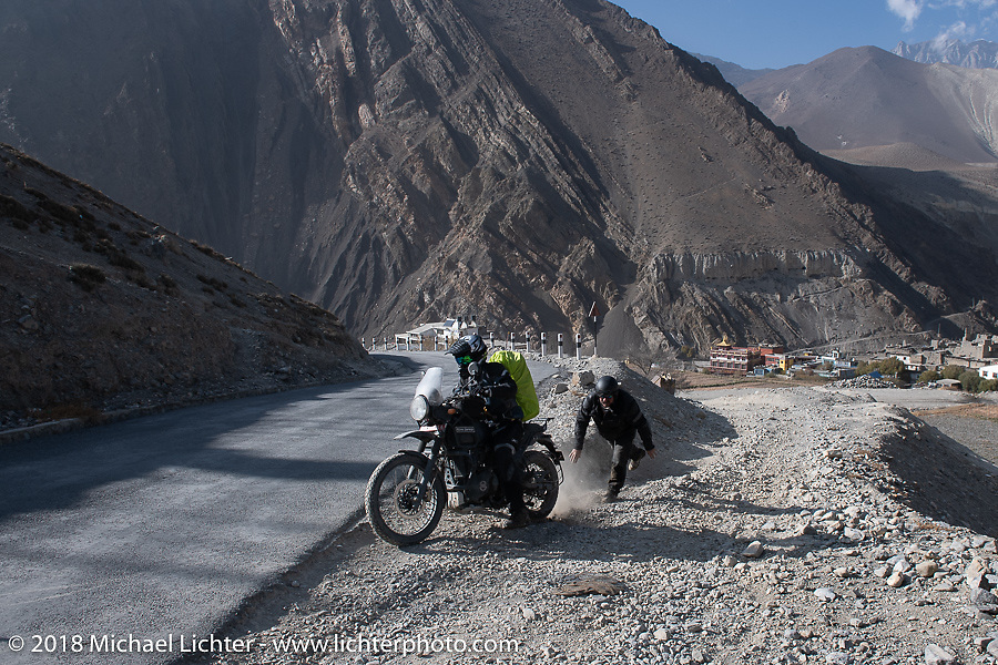 Sean Lichter passing through Kagbeni on day-5  of our Himalayan Heroes adventure riding from Kalopani through the Mustang District to our highest elevation of the trip at over 12,000' when we reached Muktinath, Nepal. Saturday, November 10, 2018. Photography ©2018 Michael Lichter.