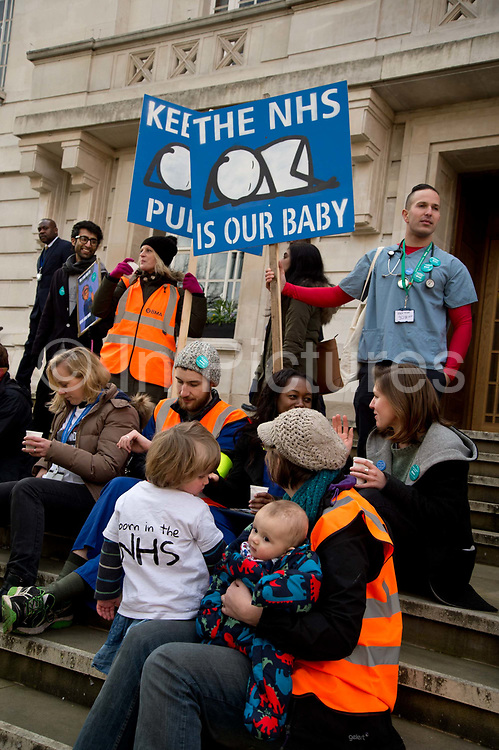 Hackney London February 10th 2016. Second one day strike by junior doctors  protesting against proposed changes to their contract including payment for working on Saturdays. Picket at Hackney Town Hall with placards by artist Stik, an image of a baby orignally made for Homerton Hospital.