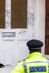 © Licensed to London News Pictures. 22/09/2018. London, UK. Marks left from fingerprint dusting by forensics on the front door of a property on Wilderton Road, Stamford Hill, North London where a man in his 20's was found stabbed to death following a fight at a flat. A second victim , a 17-year-old male , was also taken to hospital suffering a stab injury. A murder investigation has bene launched. Photo credit: Ben Cawthra/LNP