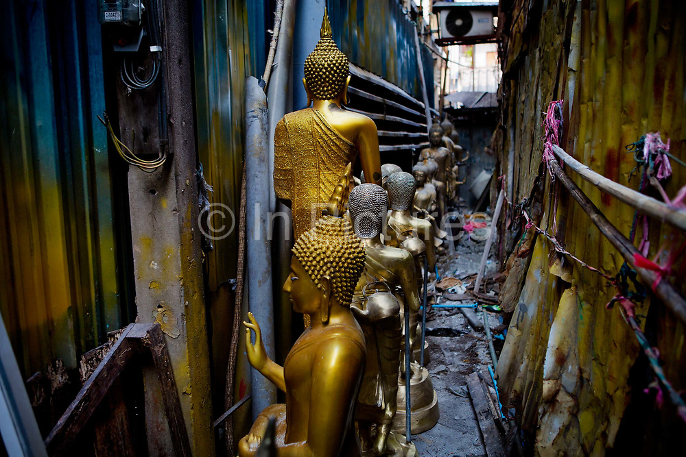 Situated in the heart of Bangkok, near the famous swing, is a series of streets and alleyways dedicated to the manufacture of Buddhist and Hindu icons together with other religious paraphernalia.